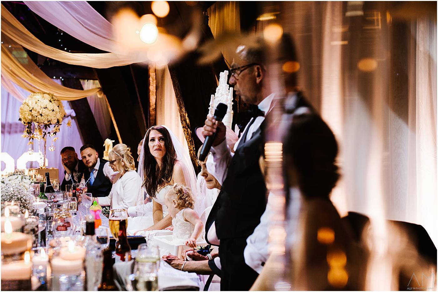 bride listening to her fathers wedding speech