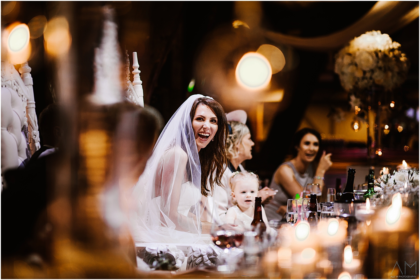 bride smiling during speeches