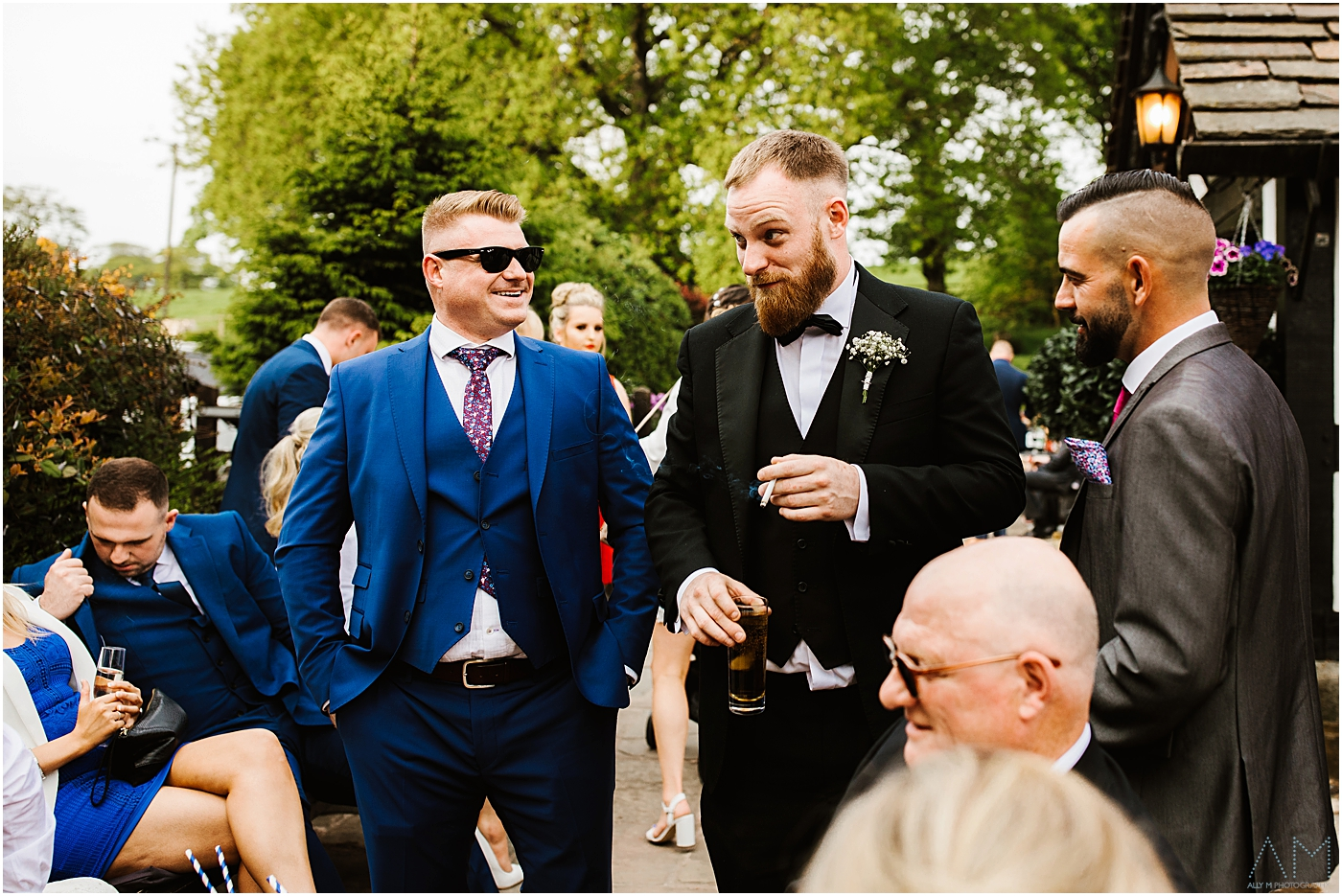 Best man laughing with wedding guests