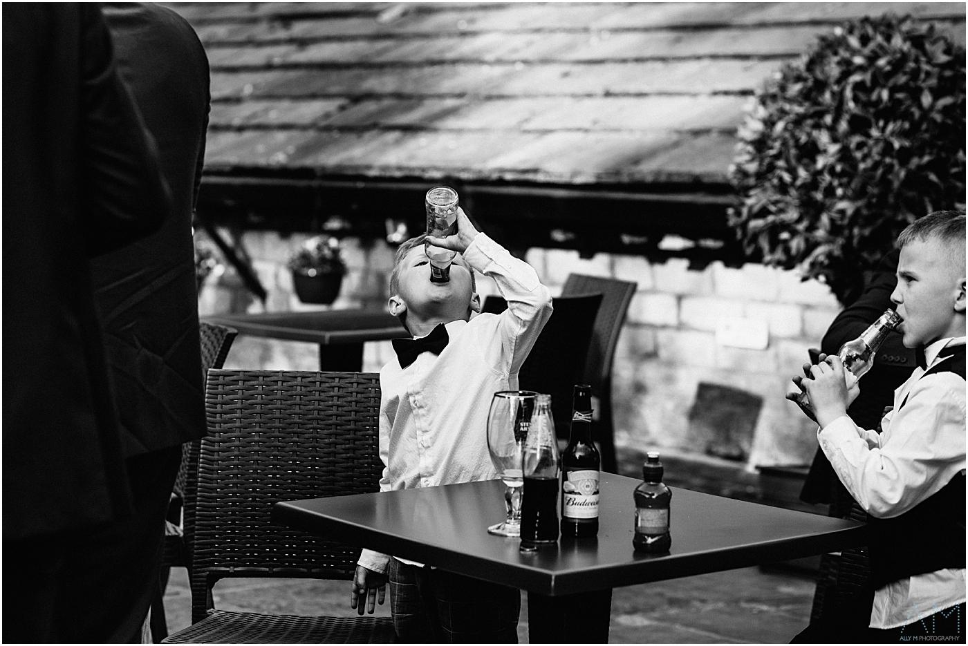 little boy drinking