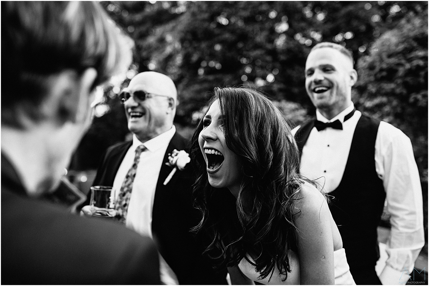Bride laughing with her guests