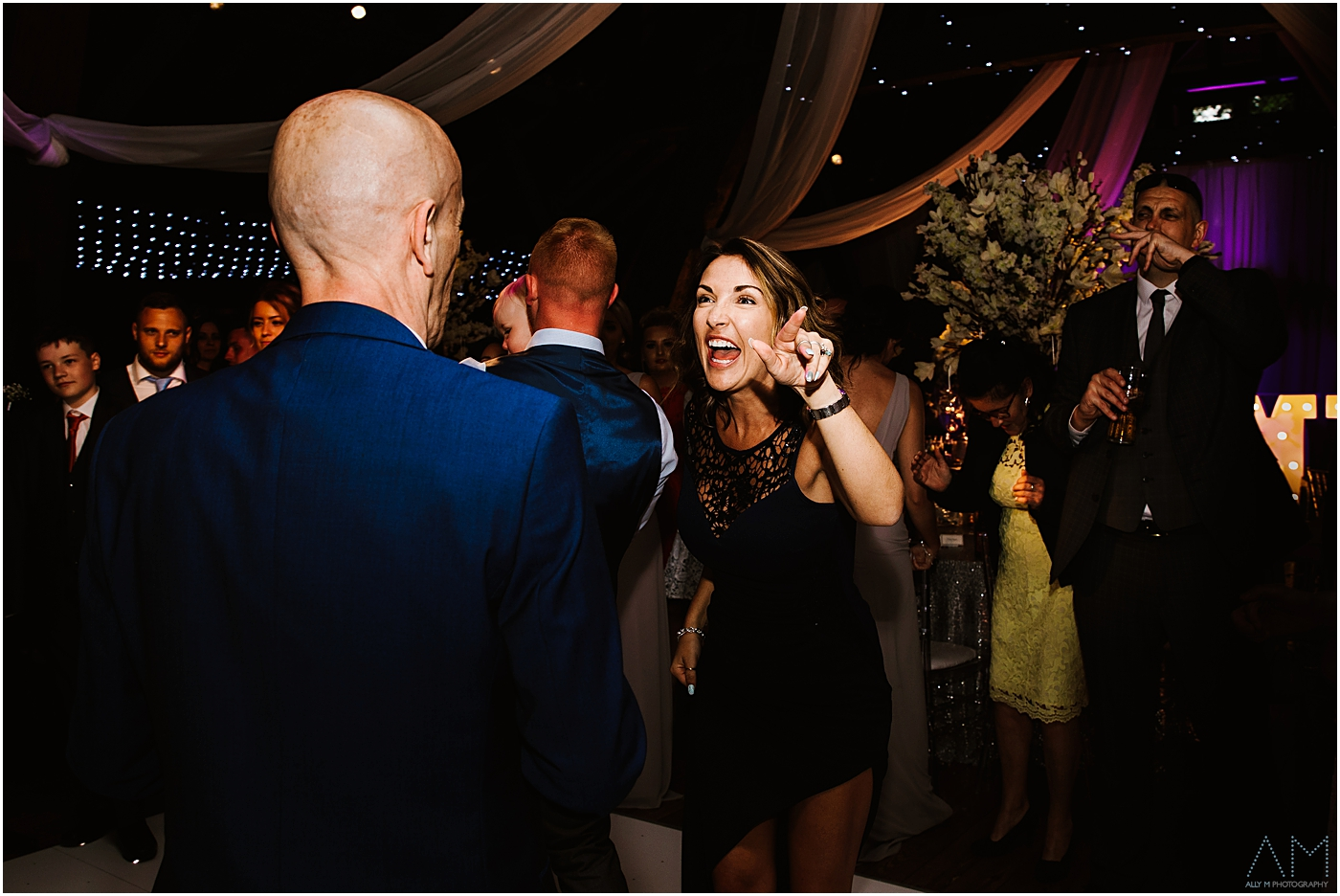 wedding guest pulling her face at her dad