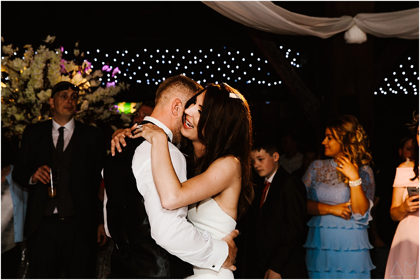 bride and groom dancing together