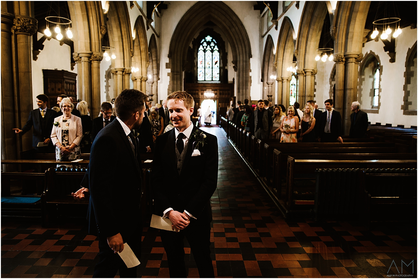 Groom and best man in the church
