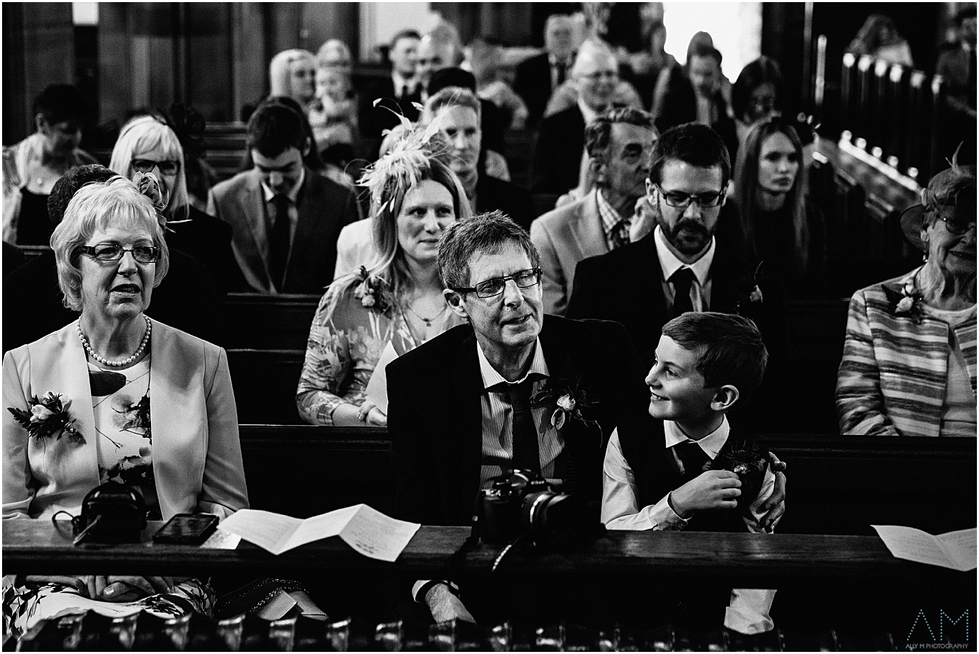 proud dad looking on at church