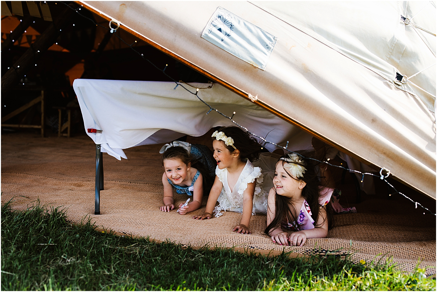 Children hiding under the teepee at new hill farm stud in manchester