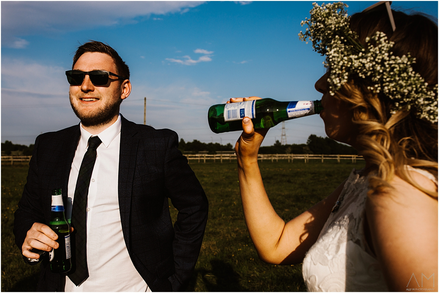 Bride drinking lager with a friend