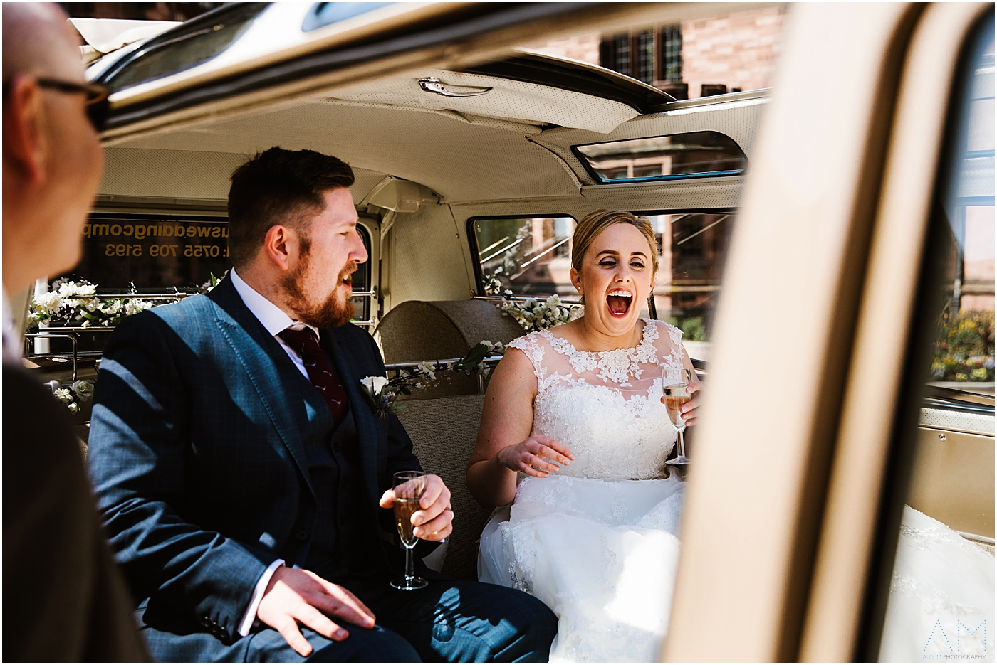 Bride and groom laughing in camper van