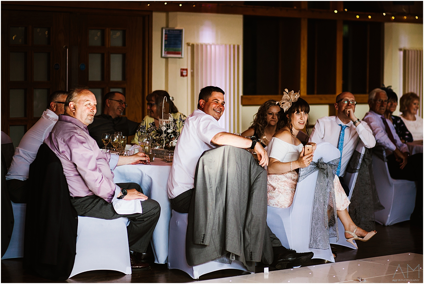 Wedding guests smiling during speeches