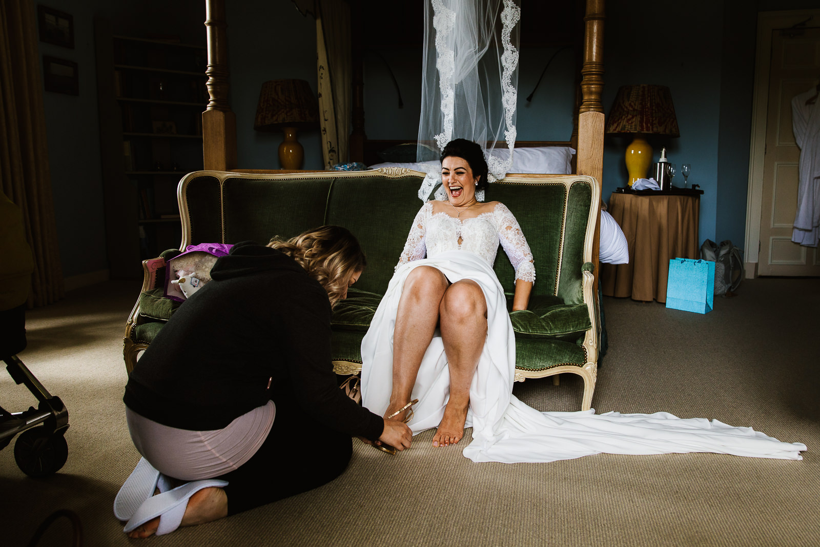 Bride getting help with her shoes