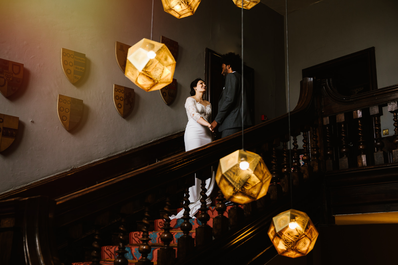 Bride and groom on the staircase at Askham Hall