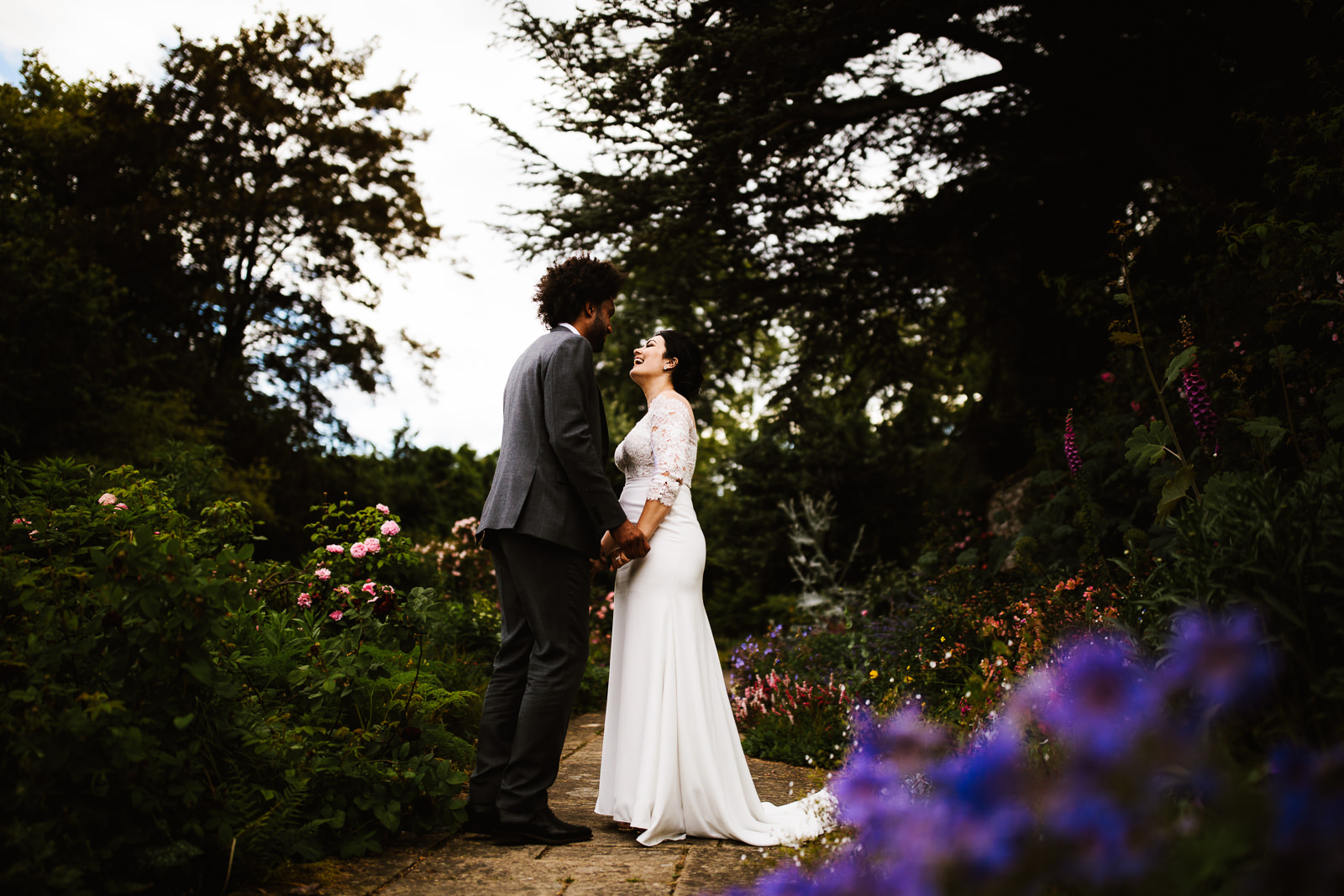 Bride and groom together in the gardens at Askham Hall