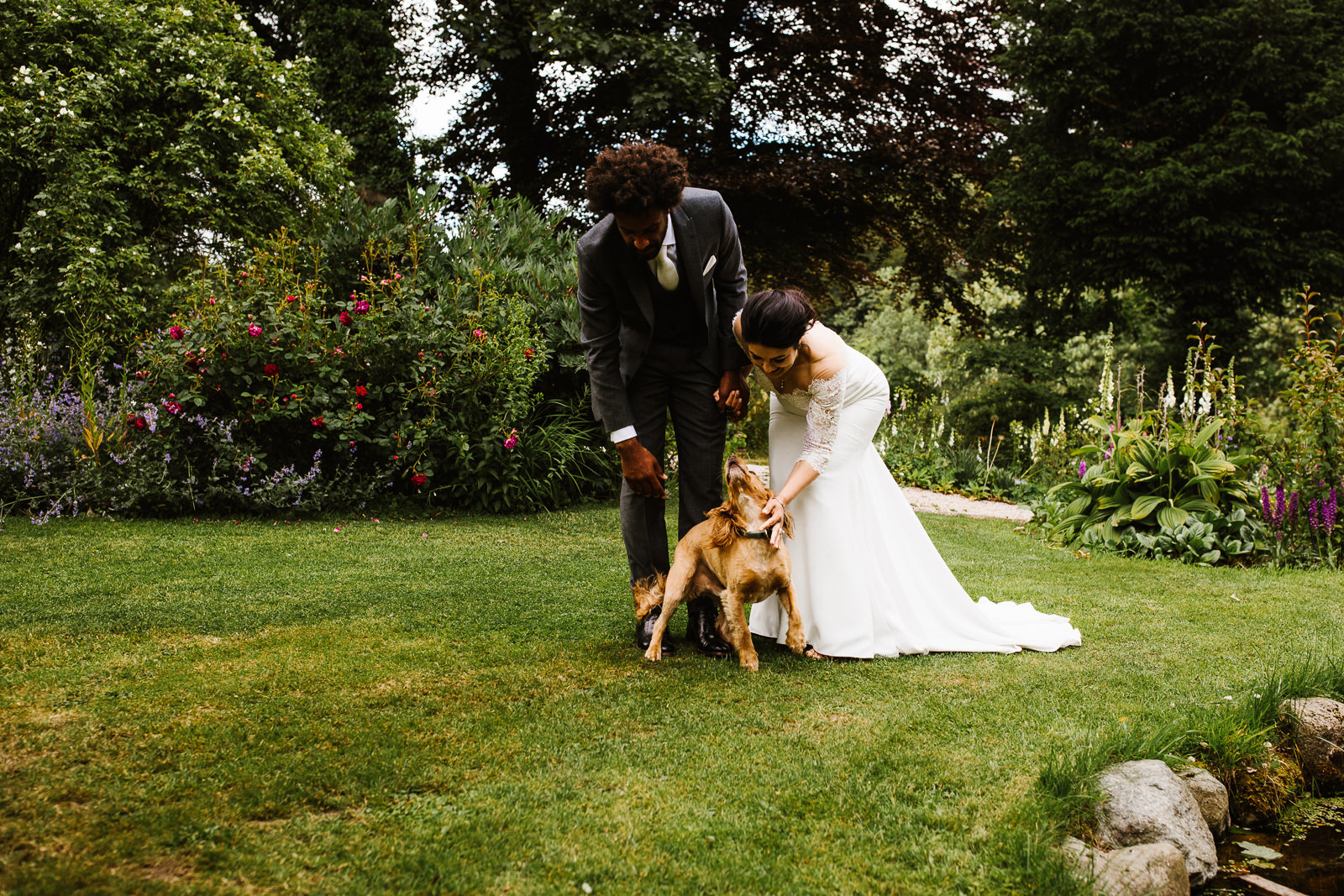 Bride and groom with their dog at Askham Hall
