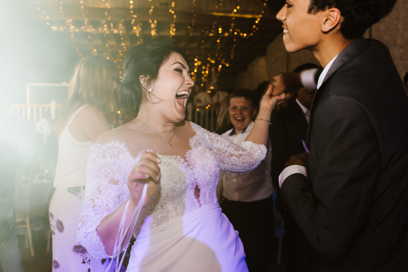 Bride dancing with her son