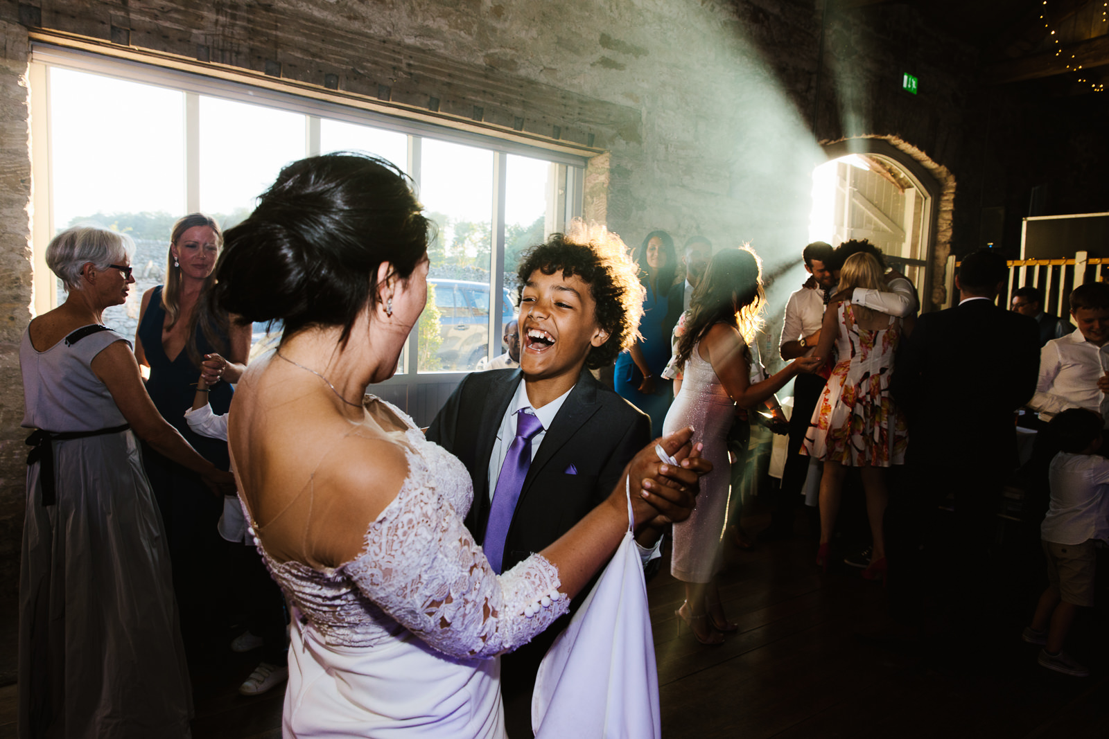Bride and her boy dancing together
