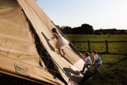 Kids climbing teepee