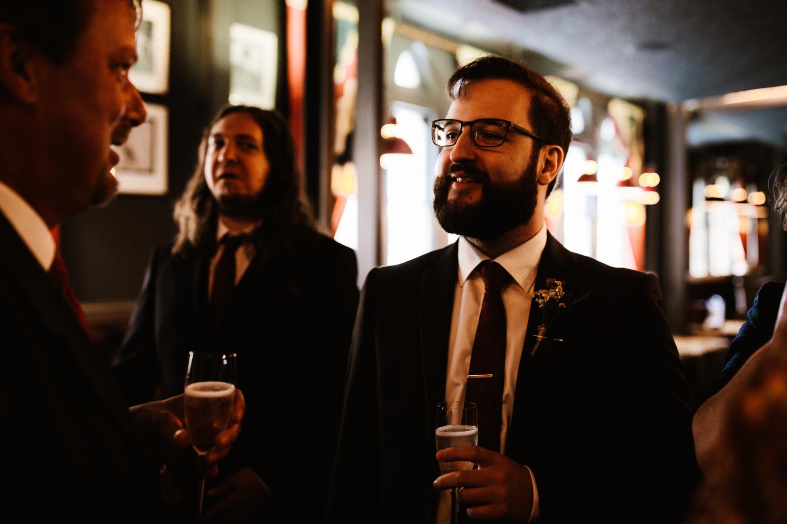 Wedding guest drinking beer