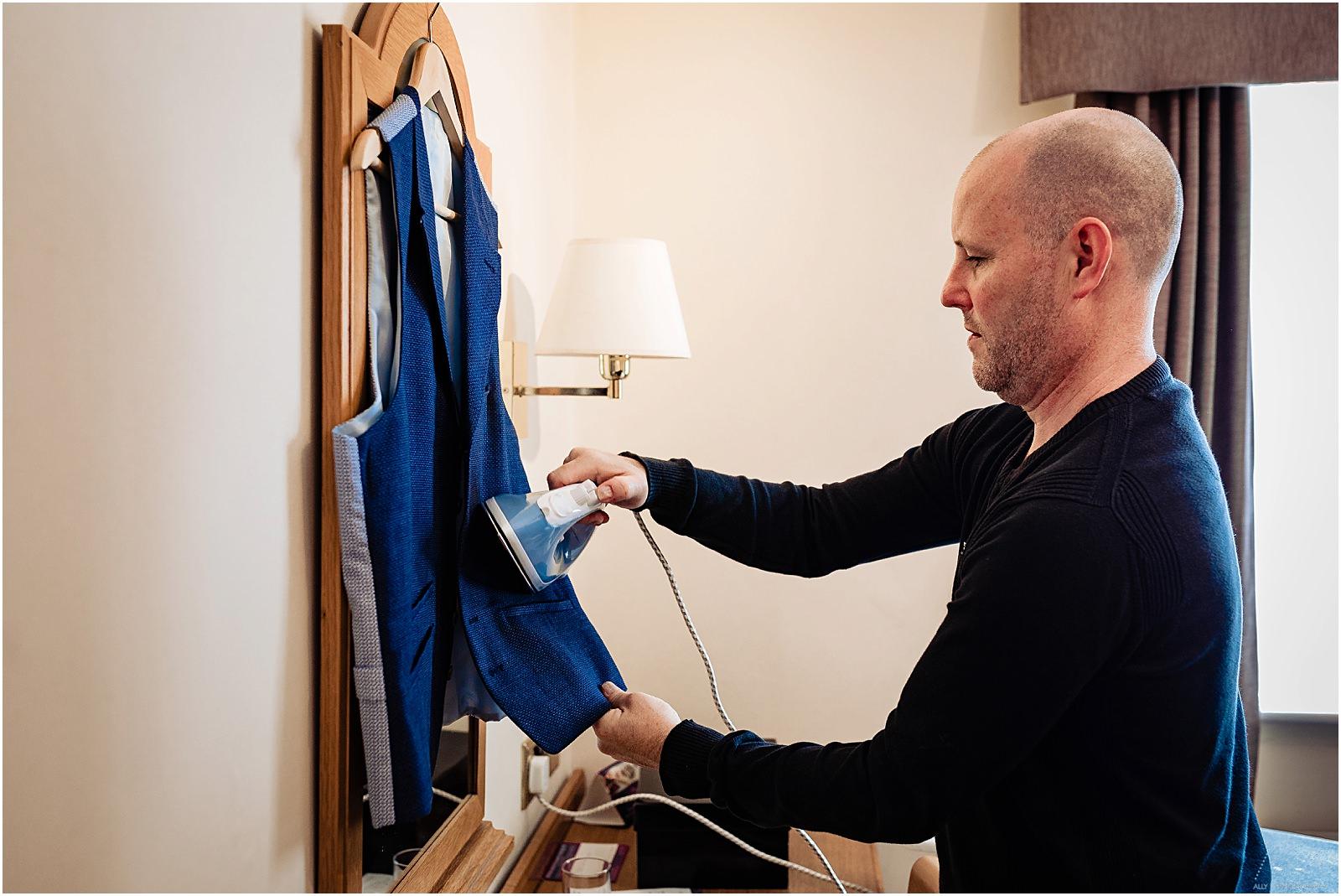 groom ironing his waistcoat