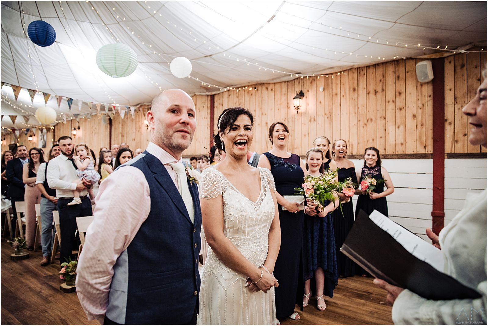 Bride and groom laughing at Wellbeing farm