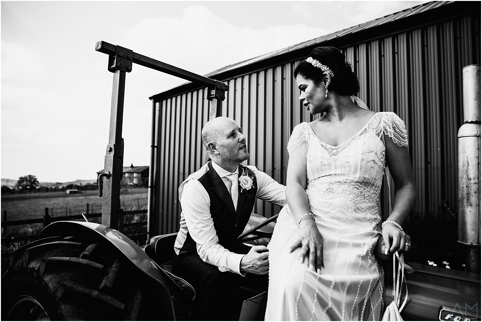 Newly weds sat on the tractor