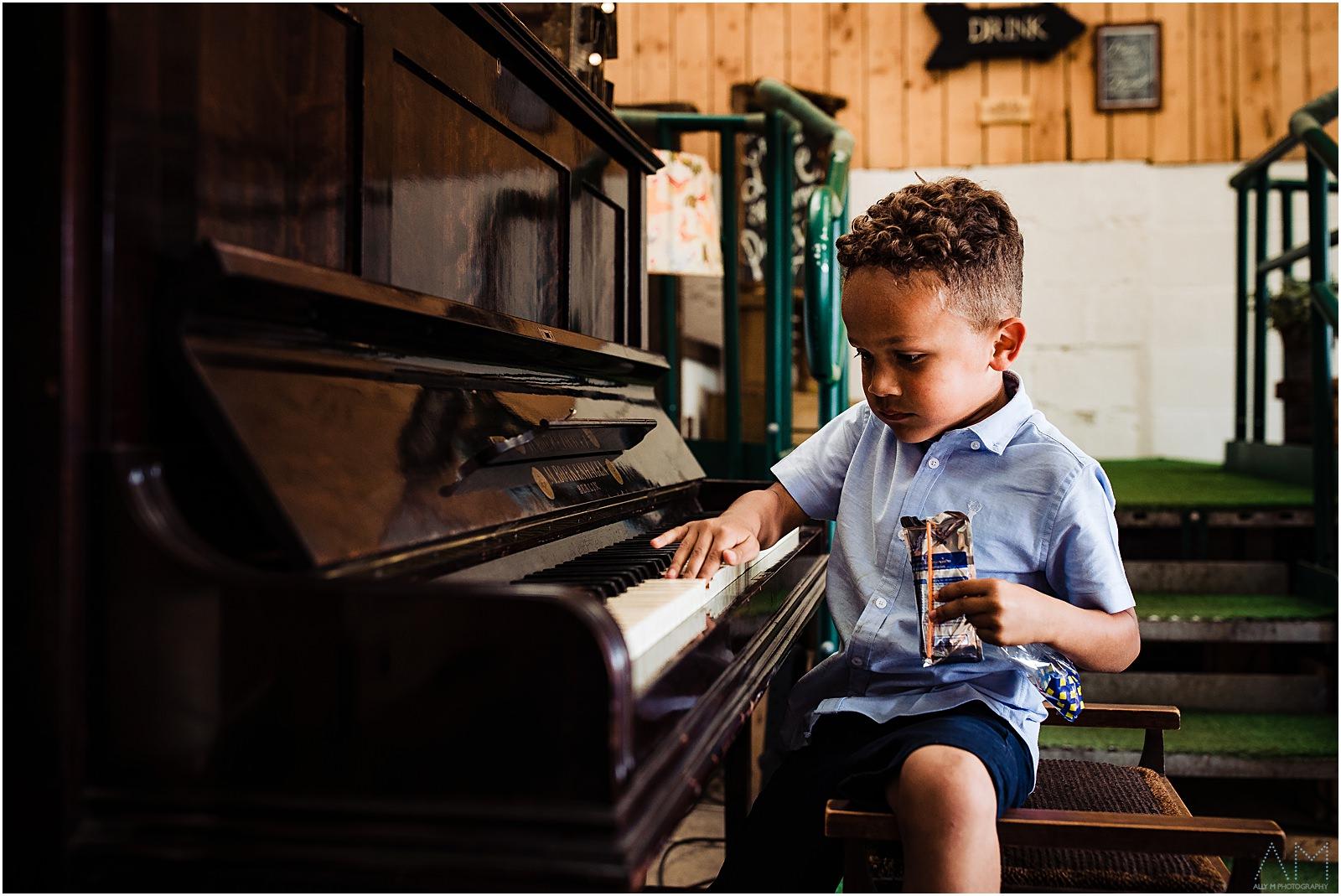 little boy on a piano