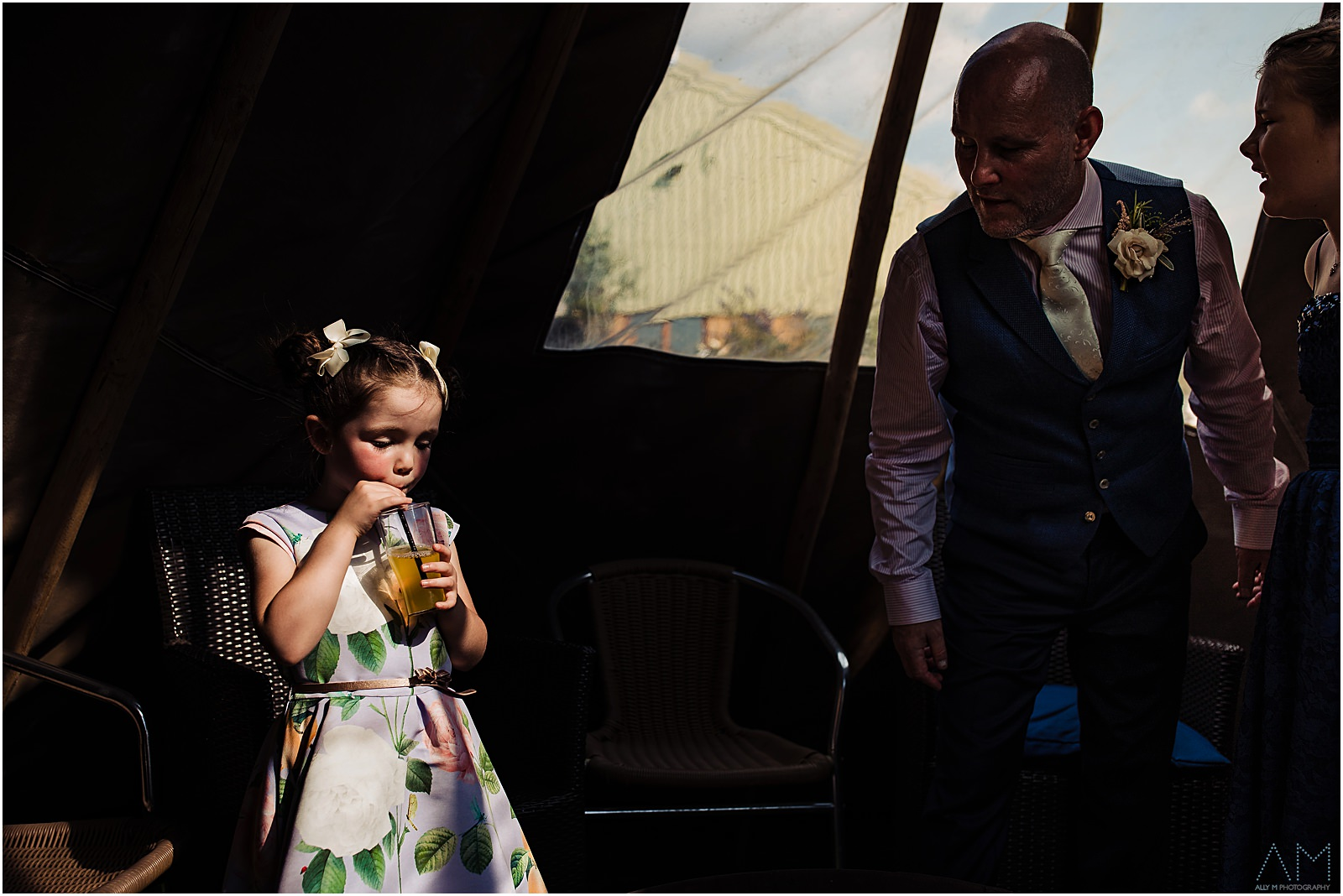 little girl having a drink in the tent