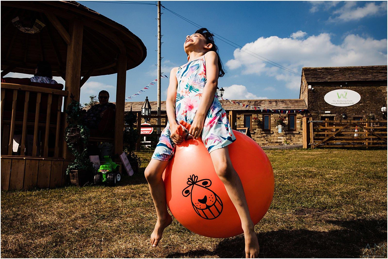 Girl bouncing on space hopper