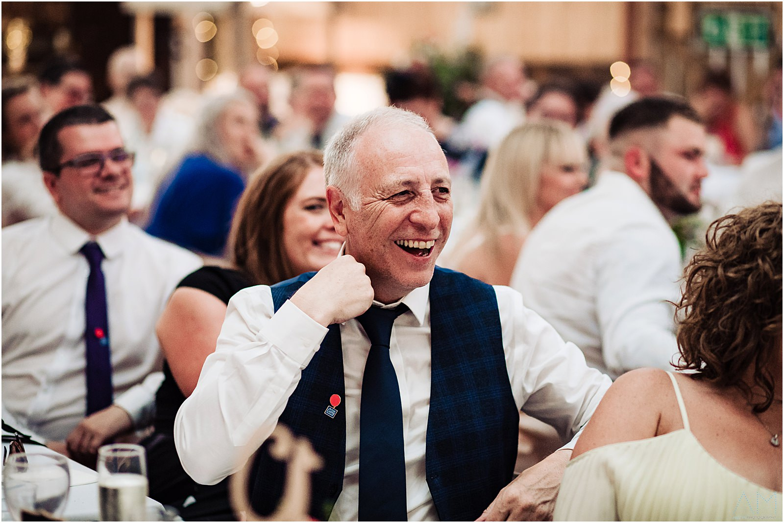 wedding guest laughing during speeches