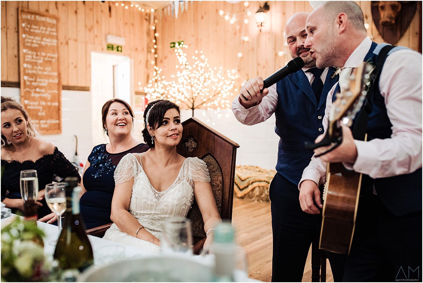 Groom singing the the bride at the wellbeing farm