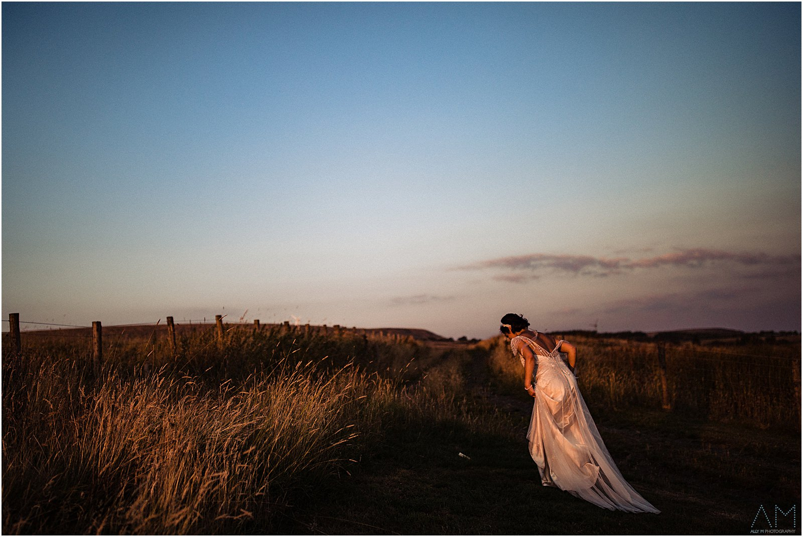 Bride walking up a hill
