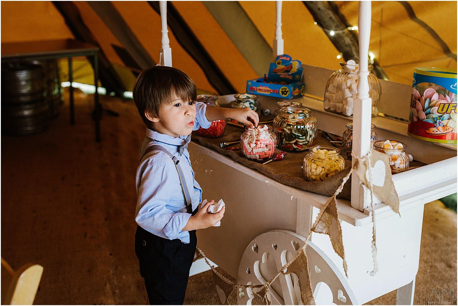 Kid pinching sweets