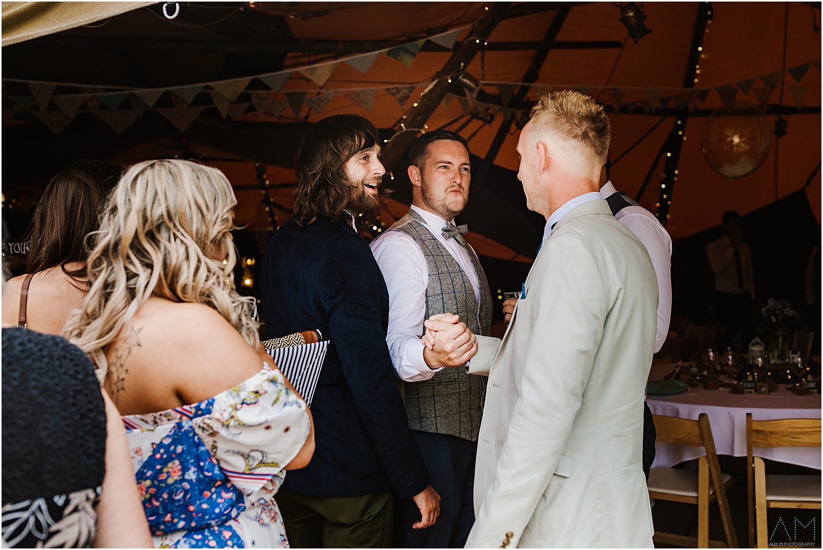 Groom shaking hand with guest
