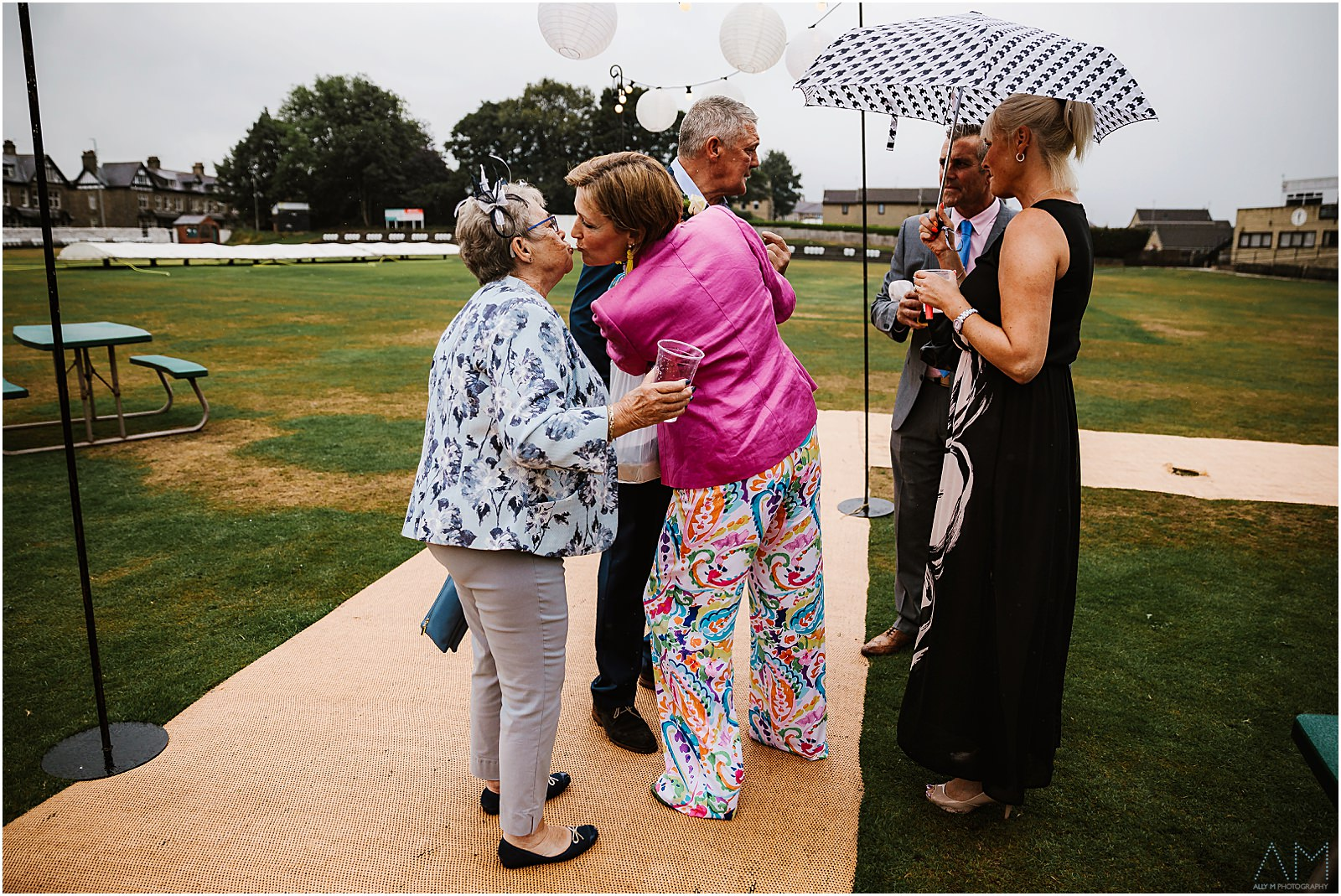 Grandma kissing one of the wedding guests