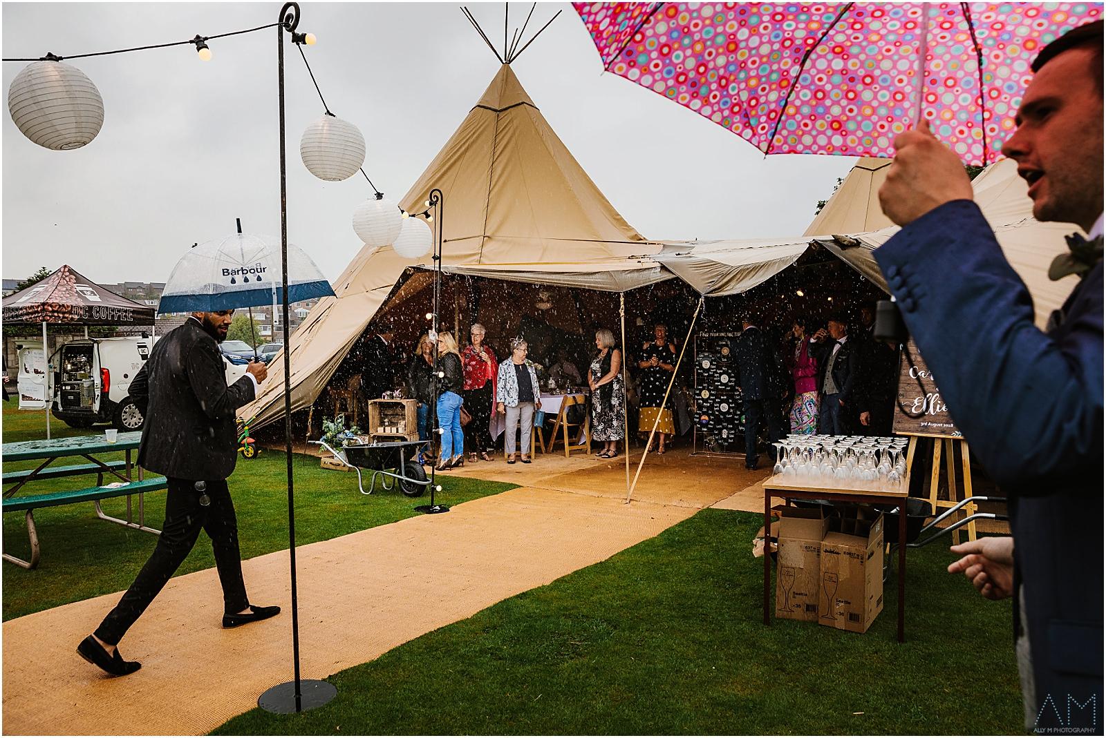 Rainy teepee wedding
