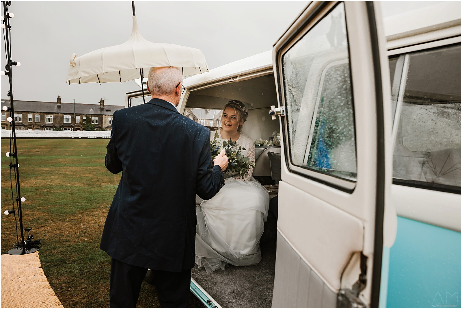 Bride arriving at wedding in campervan