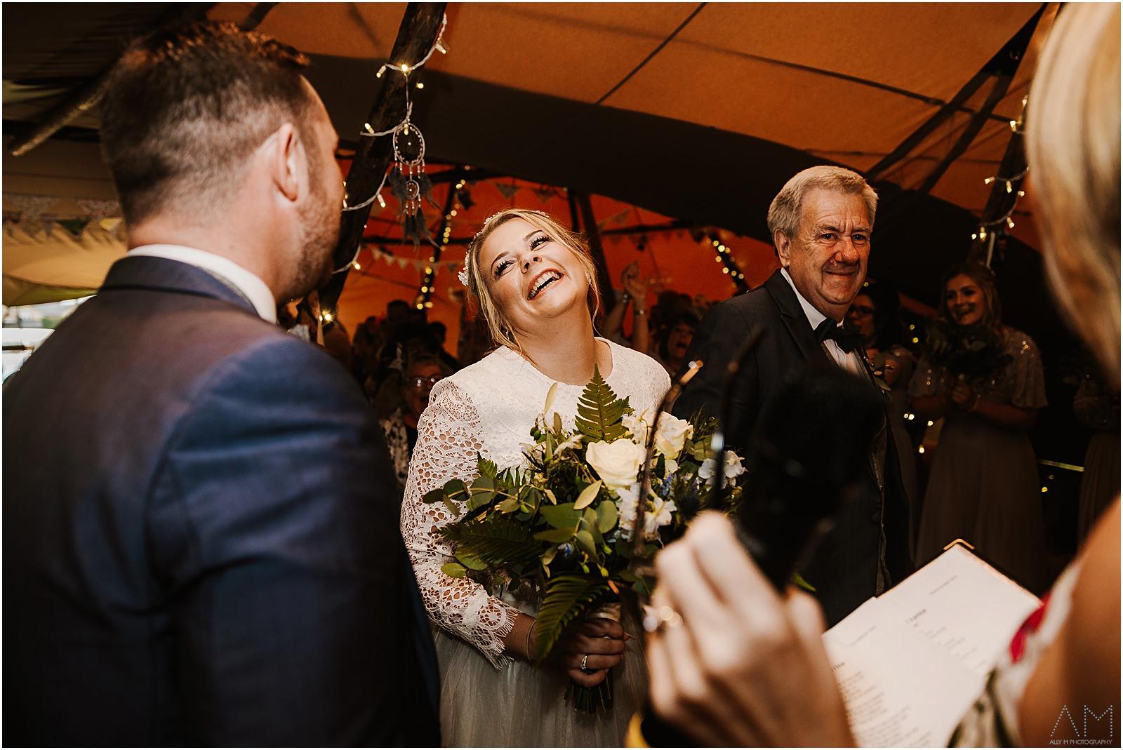 Bride smilng at her man