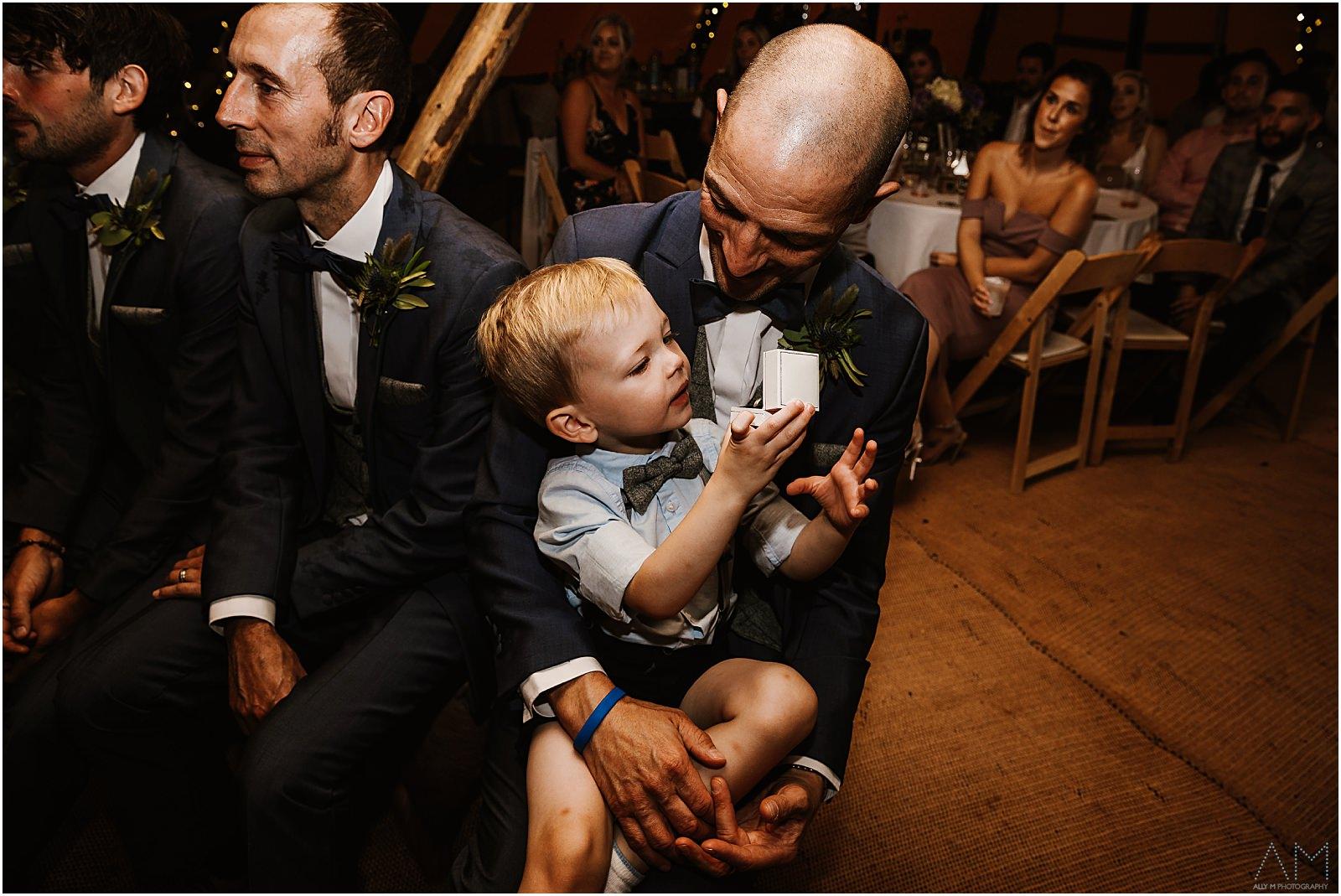 Little boy holding wedding rings