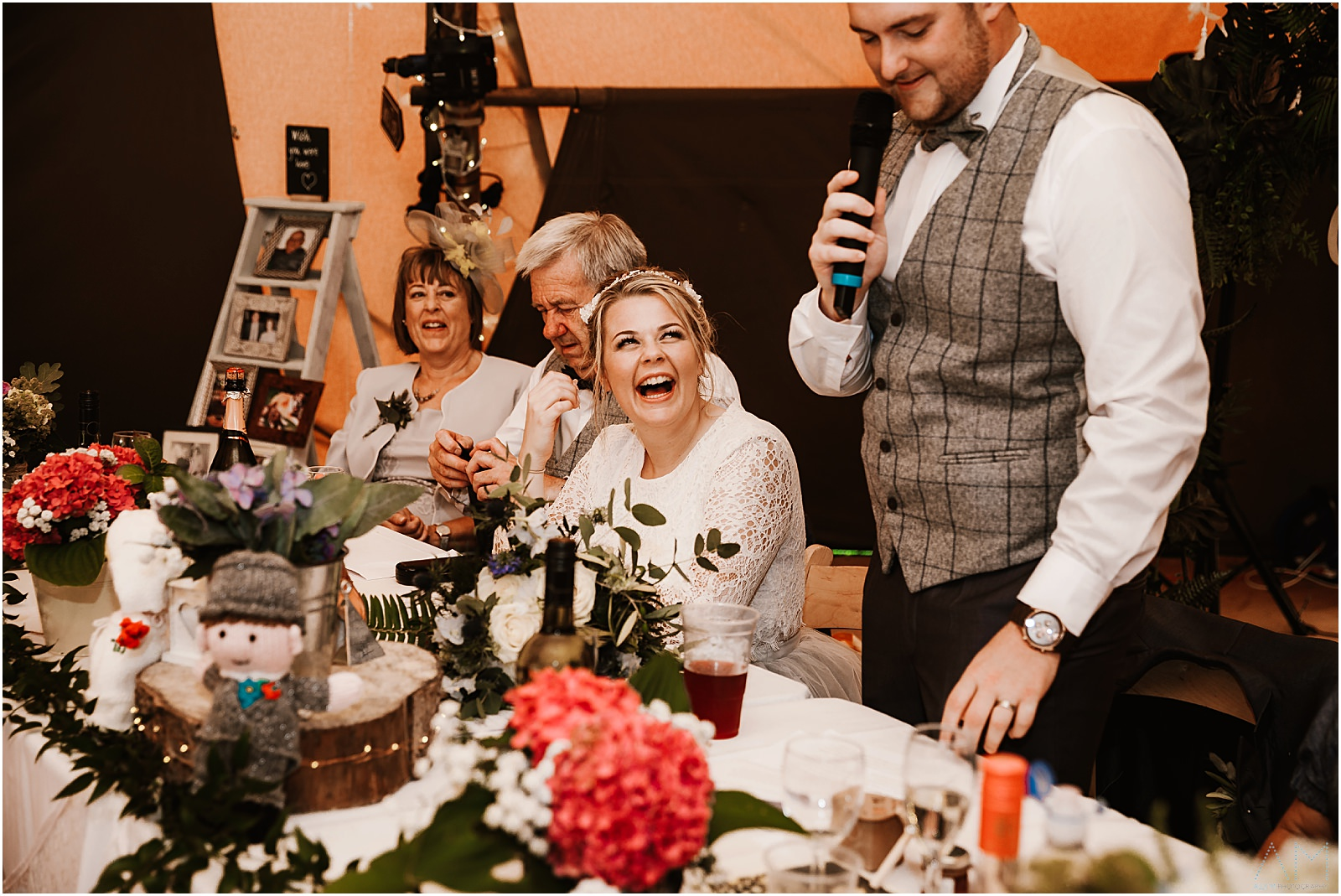 Bride laughing at the grrom during his speech