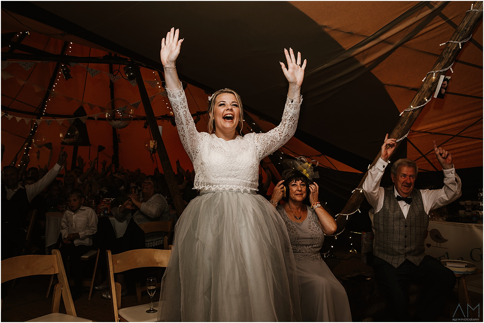 Bride standing up cheering