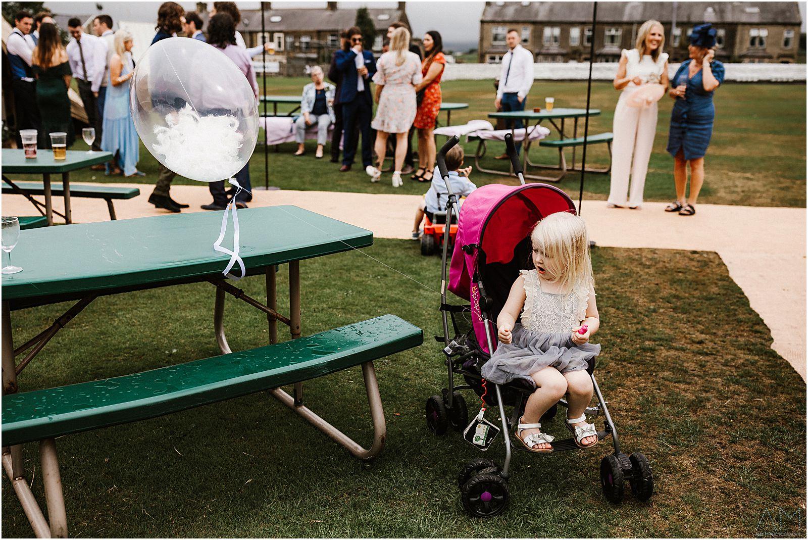 Little girl in her pram with balloon