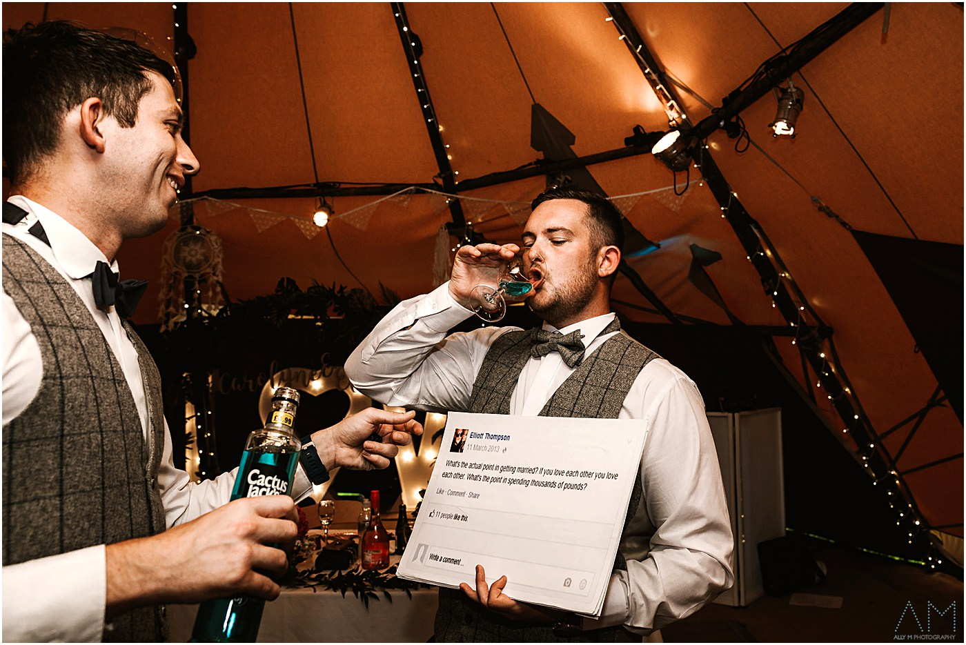 Groom drinking a shot
