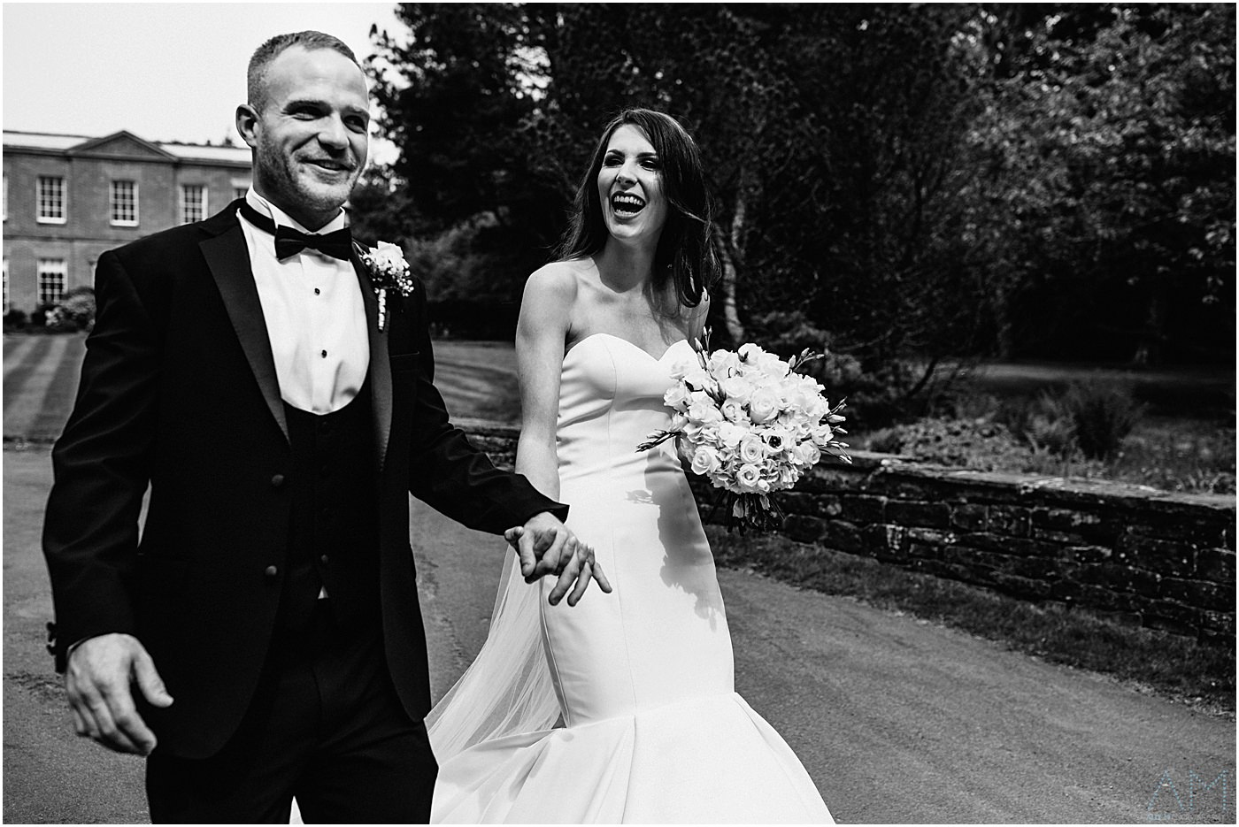 Bride and groom walking together at Rivington Hall Barn