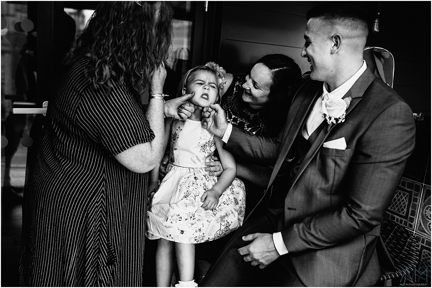 Kid pulling her face at Manchester wedding