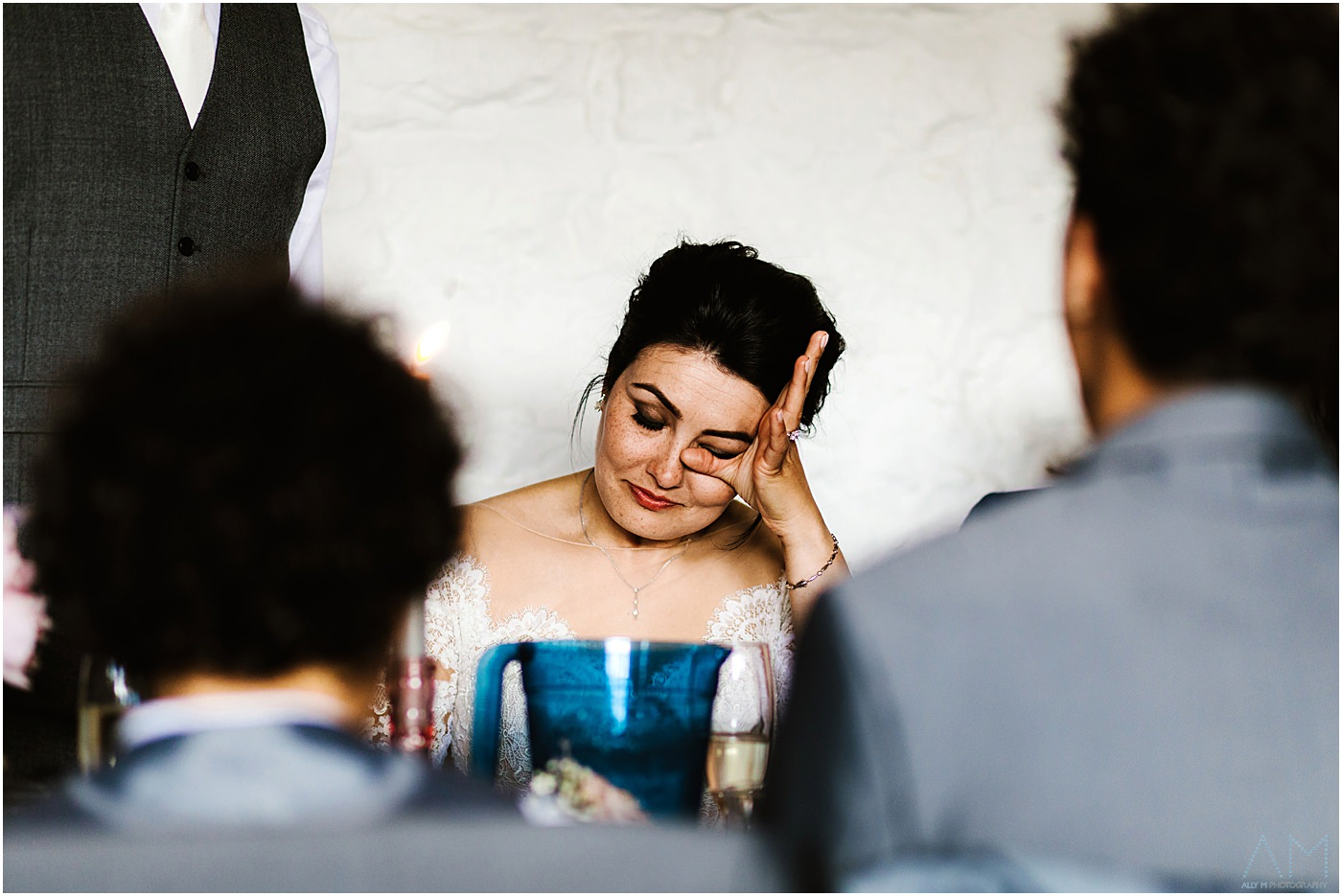 Emotional bride during speeches. Askham Hall Wedding photography