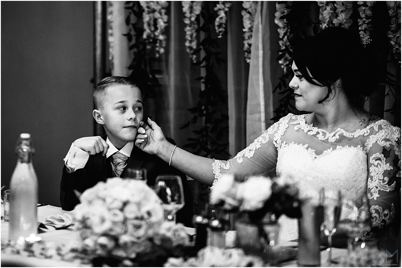 Bride stroking her sons face