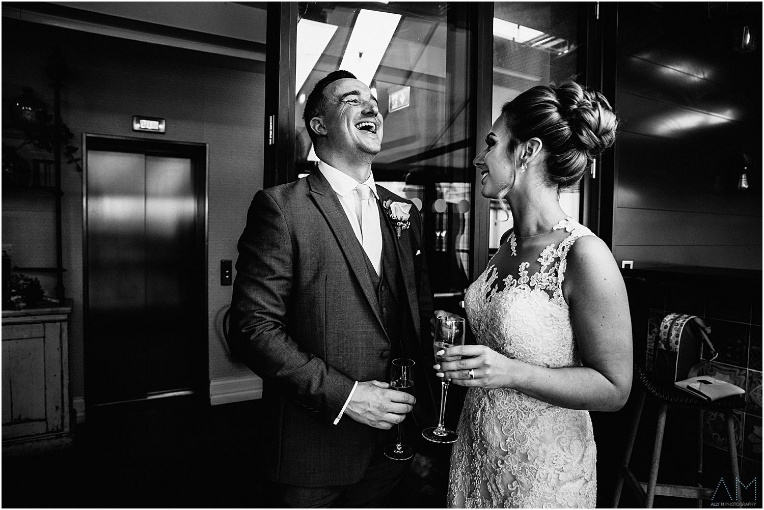 Groom laughing with his bride
