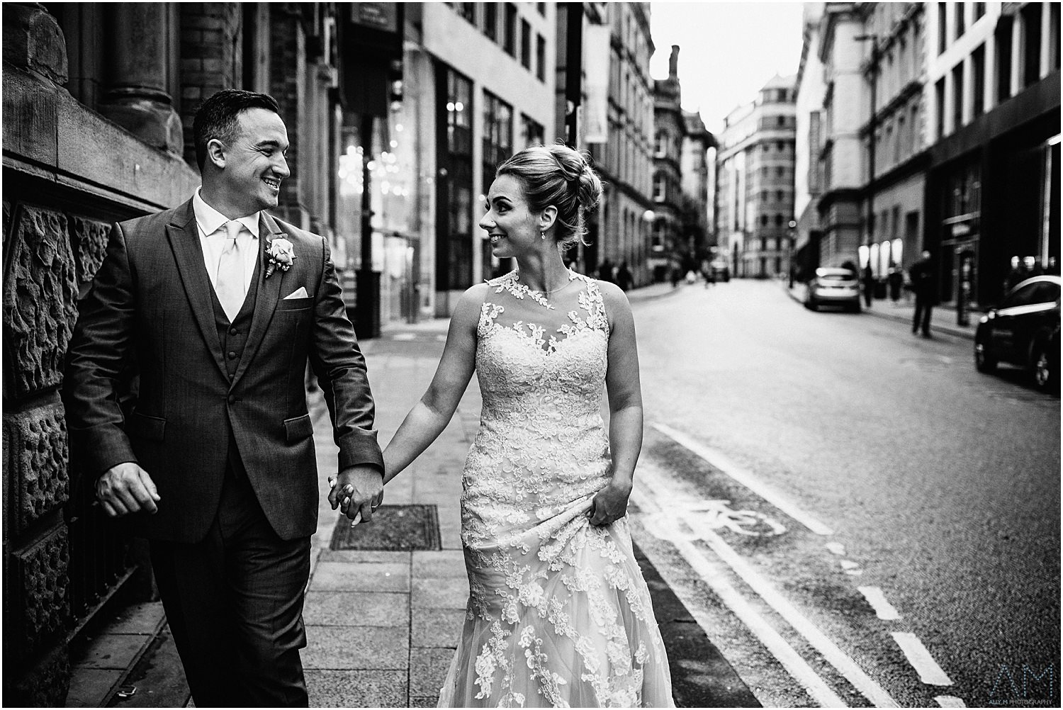 Bride amnd groom walking in manchester