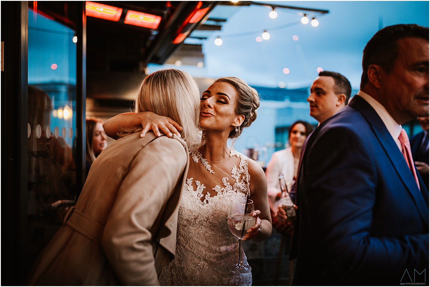 Bride kissing guest