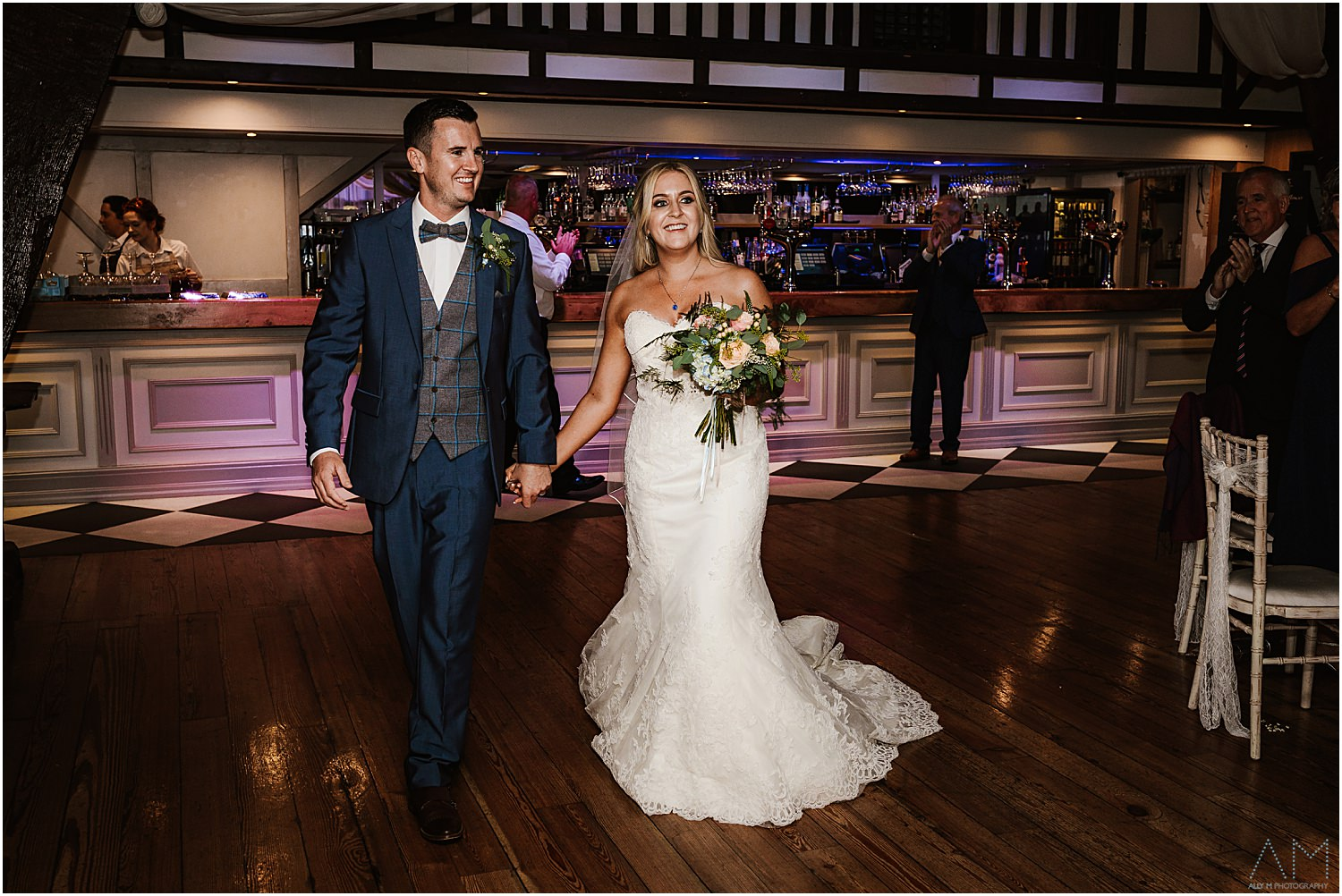 Bride and groom enter Rivington barn
