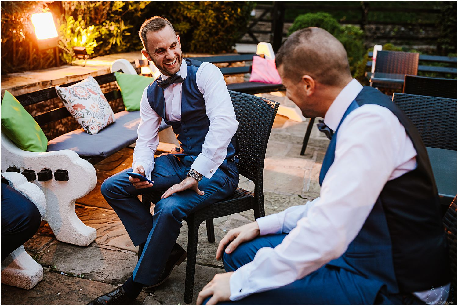 Wedding guests laughing outside